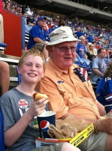 Dad and Charlie enjoying a hot dog at a Gator Game